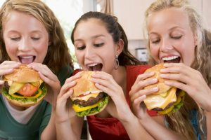 girls-eating-burgers-thrilled-h